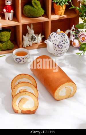 Swiss Sponge Roll With Cream on White table - Stock Photo