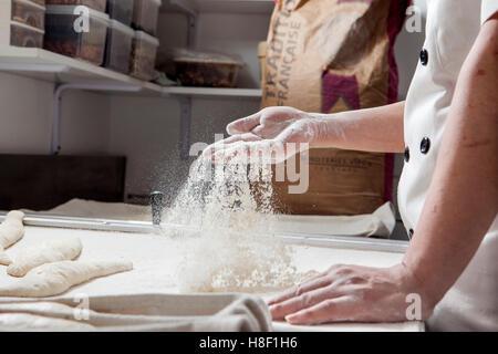 Baker is preparing bread with spelt flour - Stock Photo