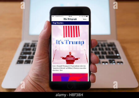 Detail of iPhone smart phone showing online mobile  newspaper front-page headline from The Telegraph following Donald - Stock Photo