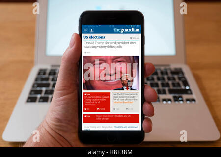 Detail of iPhone smart phone showing online mobile  newspaper front-page headline from The Guardian following Donald - Stock Photo
