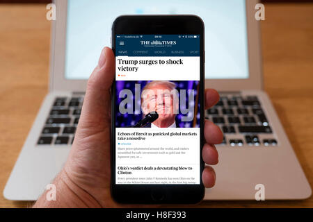 Detail of iPhone smart phone showing online mobile  newspaper front-page headline from The Times  following Donald - Stock Photo