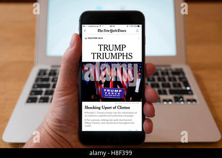 Detail of iPhone smart phone showing online mobile  newspaper front-page headline from The New York Times  following - Stock Photo