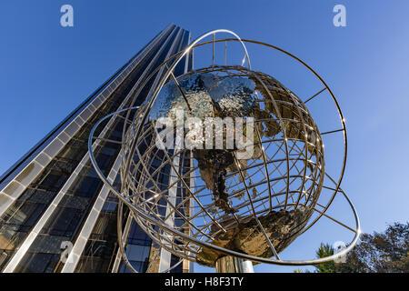 Trump International Hotel and Tower skyscraper with metal globe sculpture. Midtown, Manhattan, New York City - Stock Photo