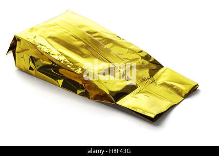 Golden Yellow Aluminum Pouch Lying on White Background - Stock Photo