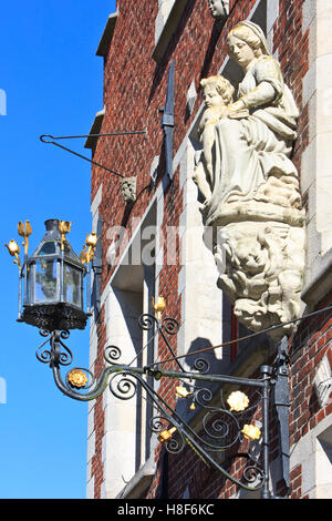 Statue of Madonna with child located at the entrance of the Princely Beguinage Ten Wijngaerde in Bruges, Belgium. - Stock Photo