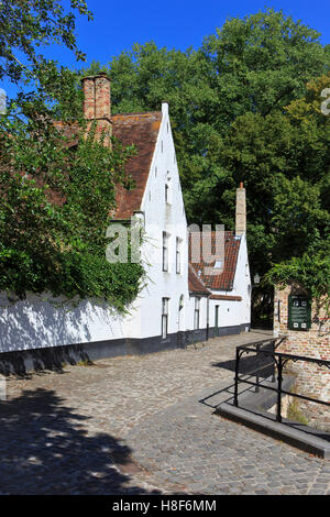 Traditional houses at the Princely Beguinage Ten Wijngaerde (1245) in Bruges, Belgium - Stock Photo