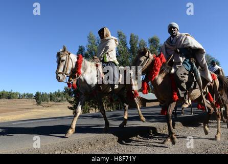 Amhara horsemen riding their horses in the mountainous highlands region of Ethiopia - Stock Photo