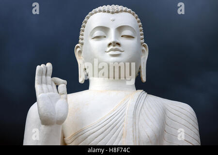 Buddha statue, stormy atmosphere, Mihintale, North Central Province, Sri Lanka - Stock Photo