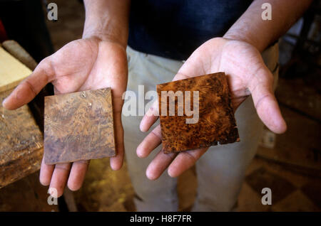 Polishing a thuya root piece, before and after, marquetry at Essaouira, Morocco, North Africa - Stock Photo