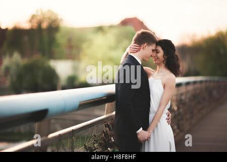 Gorgeous wedding couple, bride and groom posing on bridge in Krakow - Stock Photo