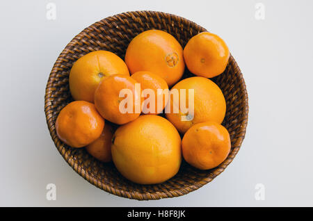 Citrus fruit in a basket - Stock Photo