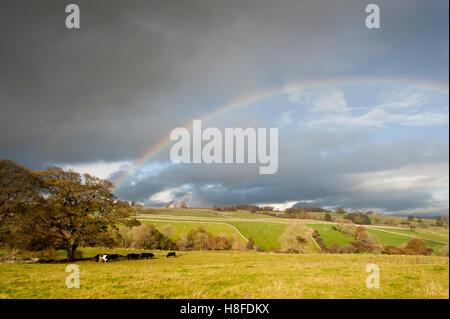 Rainbow over farmland, overlooking the Eden Valley, Cumbria, UK. - Stock Photo