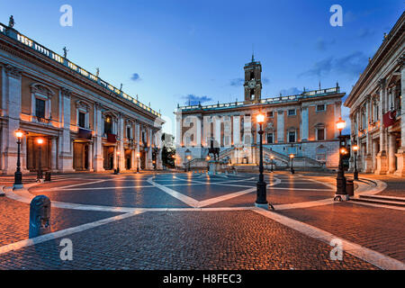 Cobblestone covered square on top of Capitoline hill in Rome, Italy, at sunrise. Historic landmark of ancient roman - Stock Photo