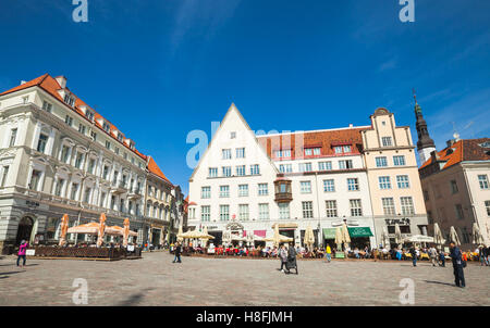 Tallinn, Estonia - May 2, 2016: Tourists and citizens are on Town Hall square in old Tallinn, bright spring sunny - Stock Photo