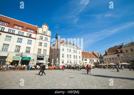 Tallinn, Estonia - May 2, 2016: Tourists and ordinary citizens walk on Town Hall square in old Tallinn, bright spring - Stock Photo