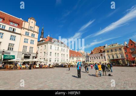 Tallinn, Estonia - May 2, 2016: Tourists walking on Town Hall square in old Tallinn, bright spring sunny day - Stock Photo