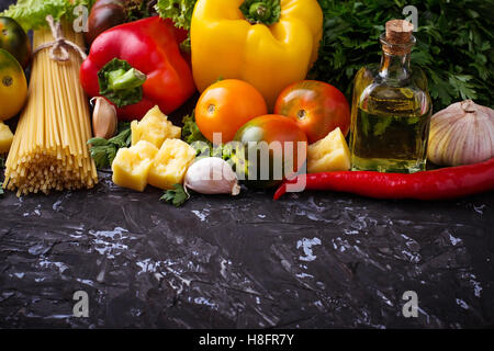 Concept of Italian food. Pasta, tomato, olive oil, pepper, parsley and cheese. Selective focus. - Stock Photo