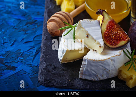 Camembert cheese with  figs, honey and wine. Selective focus. - Stock Photo