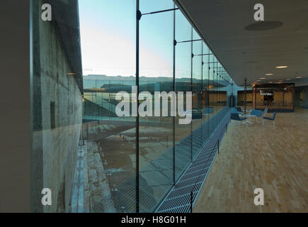 View through glass walls to the raw dry dock walls at Danish Maritime Museum, M/S Museet for Søfart, in Elsinore - Stock Photo