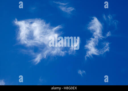 what shape can you see in these clouds looks like superman or an angle of the north horns arms out-stretched flying - Stock Photo