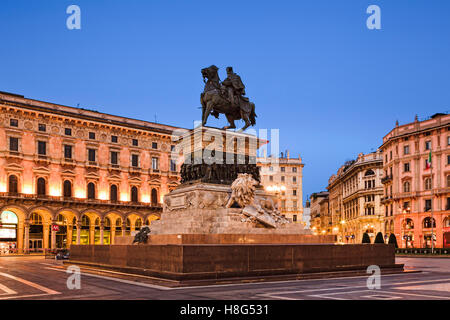 Equestrian statue of Vittorio Emanuele on Cathedral square in Milan, Italy, at sunrise - Stock Photo
