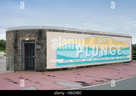Take the plunge, toilet block on former swimming pool in Morecambe Lancashire UK - Stock Photo
