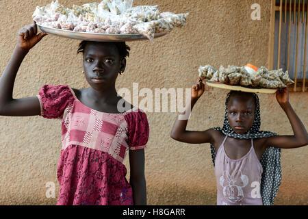 BURKINA FASO, Bobo Dioulasso, child labour, girl sell nuts / Kinderarbeit, Maedchen verkauft Erdnuesse - Stock Photo