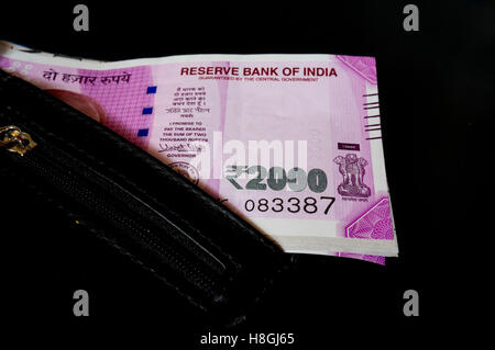 Indian rupee 2000 notes in black leather wallet - Stock Photo