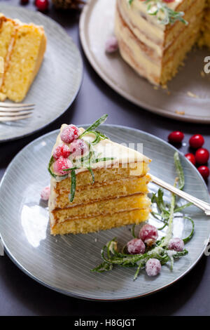 layered Christmas cake with sugared cranberries and rosemary - Stock Photo