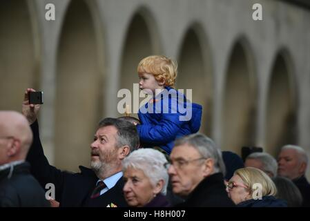 Manchester  UK  13th November 2016  A young boy has a good view of proceedings at the Remembrance Day service at - Stock Photo