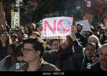 New York, New York, USA. 12th Nov, 2016. Thousands of people rally and march to Trump Tower in protest of president - Stock Photo
