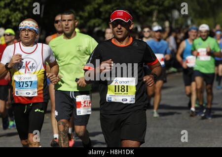 Athens, Greece. 13th November 2016. A group of runners run in the Athens Marathon. Thousands of people from all - Stock Photo