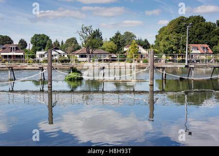 Weir on River Thames near Sunbury Lock, Sunbury-on-Thames, Surrey, England, United Kingdom - Stock Photo
