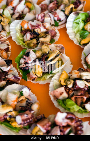 Mixed seafood salad, mussels, octopus and shrimps - Stock Photo