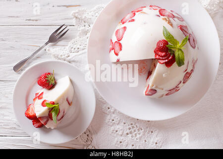 Mascarpone cheese cake and fresh strawberries close-up on the table. Horizontal view from above - Stock Photo