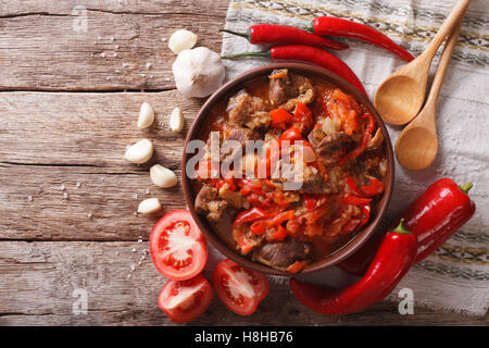 Oriental cuisine: lamb slow stewed with vegetables in a bowl close-up on the table. horizontal view from above - Stock Photo