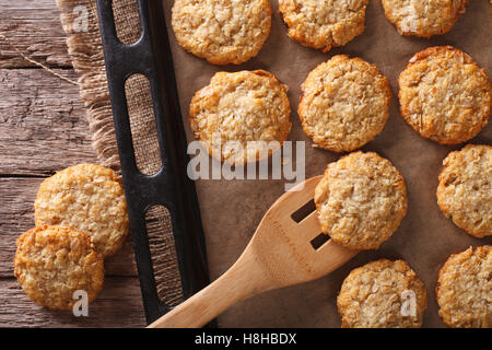 Anzac biscuits close up in baking dish on the table. horizontal view from above - Stock Photo