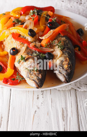 Mackerel in vegetable marinade close-up on a plate on the table. vertical - Stock Photo