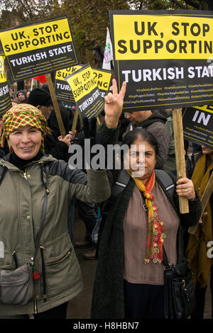Two Kurdish female protesters holding a placard against censorship and closure of kurdish political party HDP in - Stock Photo