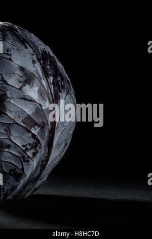 Fresh red cabbage on a black background - Stock Photo