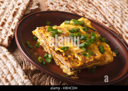 Jewish cuisine: matzah brei with green onions close-up on a plate. horizontal - Stock Photo