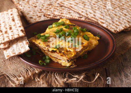 Jewish omelette: matzah brei with green onions close-up on a plate. horizontal - Stock Photo