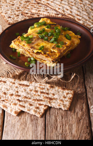 Jewish omelette: matzah brei with green onions close-up on a plate. Vertical - Stock Photo