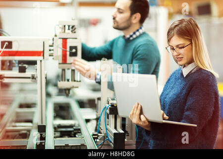 Students working on engineering class project - Stock Photo