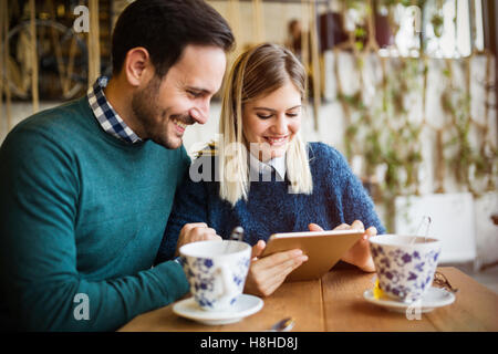 Couple in love  dating in restaurant - Stock Photo