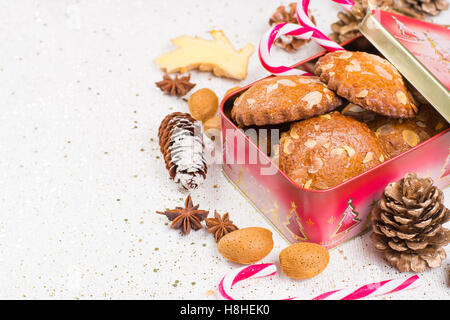 Christmas cookies with almond nuts and ginger in tin box, holiday concept - Stock Photo
