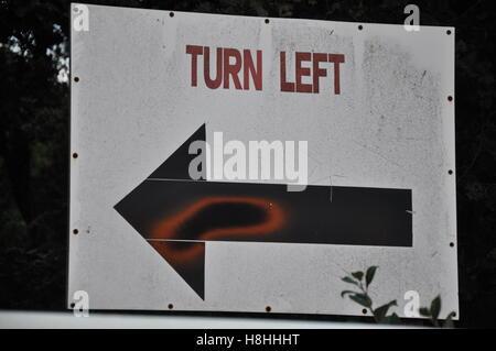 Turn left sign - Stock Photo