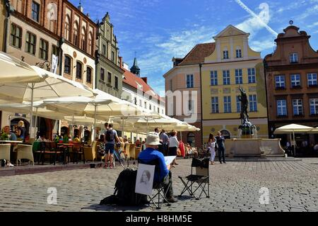 Preserved old town square in Poznan, Poland on a sunny summer day. - Stock Photo