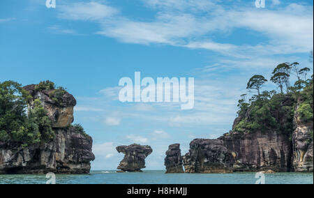 Rock formations in the ocean off the coast of Bako National Park in Malaysian Borneo. - Stock Photo
