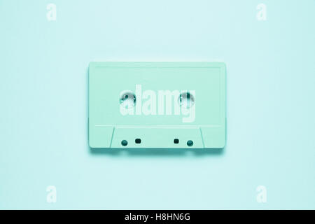 Creative photo of  painted cassette on mint background. - Stock Photo